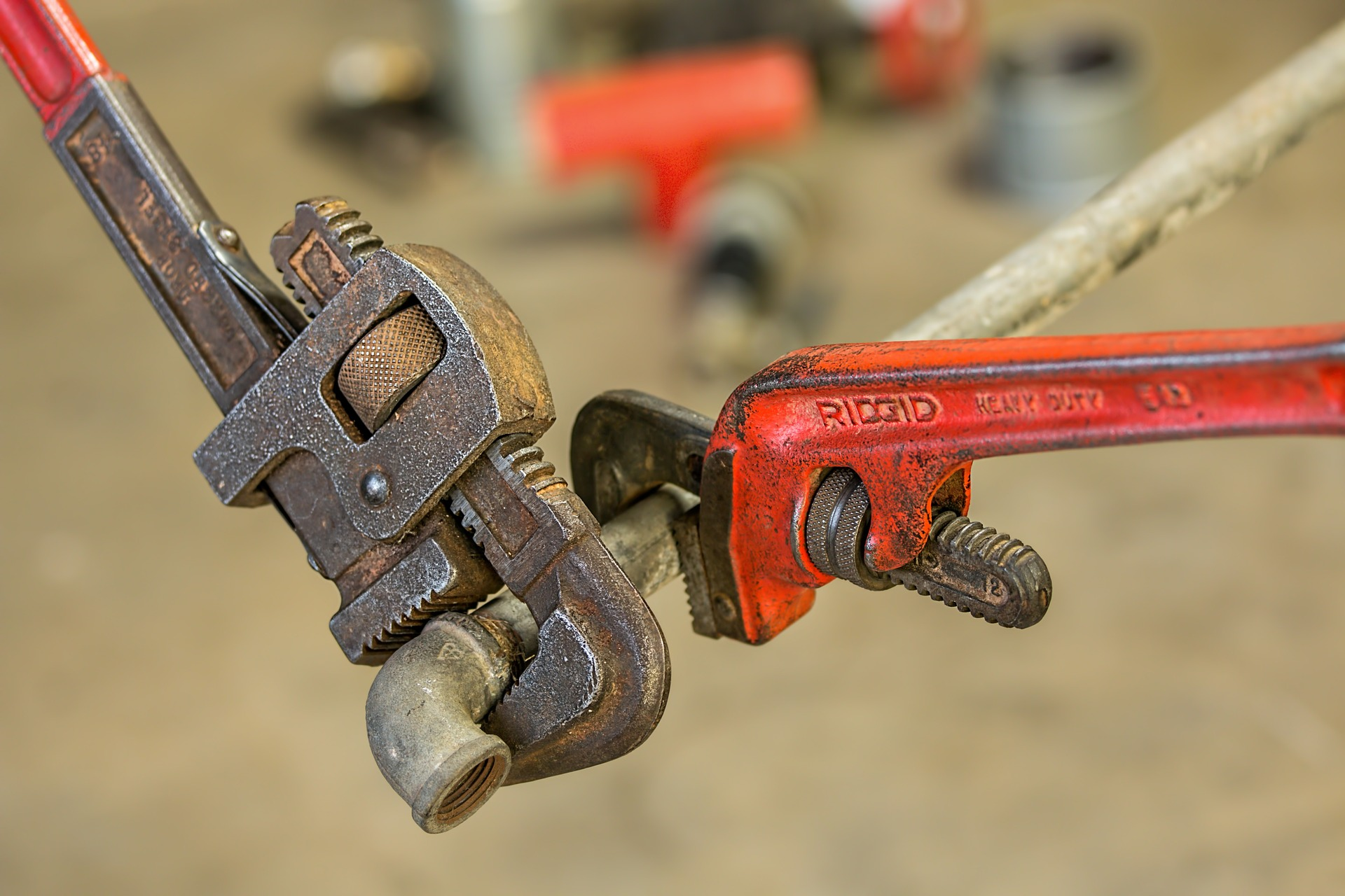 two wrenches fix pipe